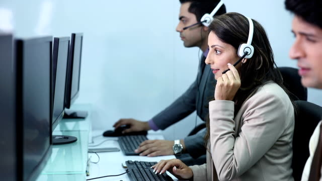 customer service representative working on computer in the office video id868504470